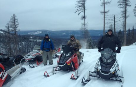 Veterans riding snowmachines at Camp Patriot