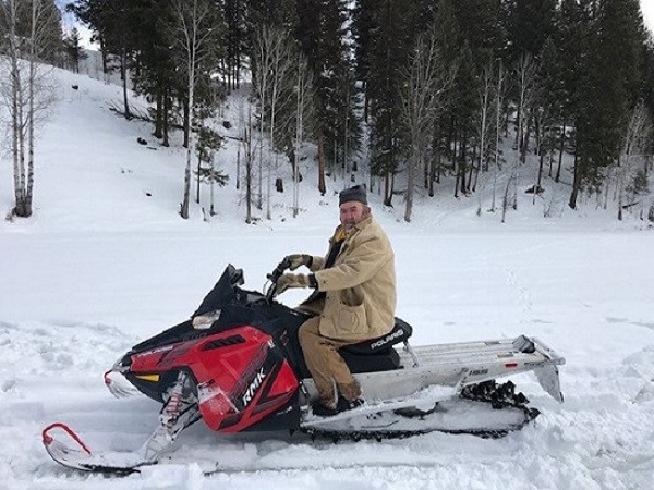 Veteran riding snowmachine at the Camp Patriot Ranch
