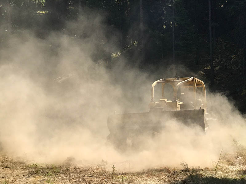 Bulldozer clearing ground for outdoor activity