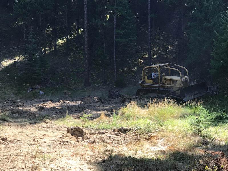 Bulldozer moving dirt for gun range
